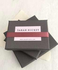 Jewellery box with sarah hickey logo and ribbon